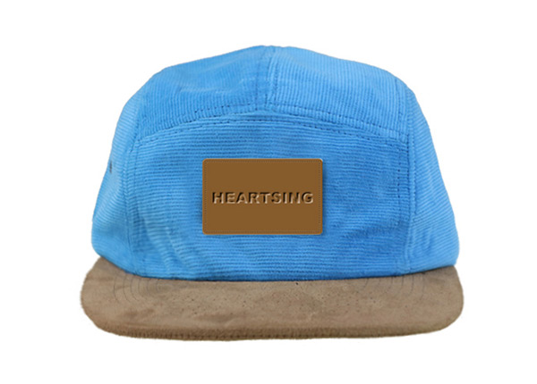 Front of Baby Blue 5 Panel Hat with Brown Suede Brim and a Leather Label