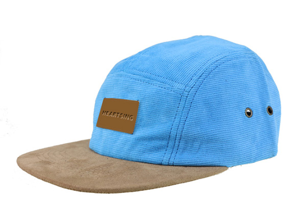 Slant of Baby Blue 5 Panel Hat with Brown Suede Brim and a Leather Label