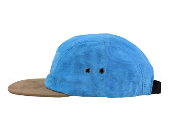 Side of Baby Blue 5 Panel Hat with Brown Suede Brim and a Leather Label
