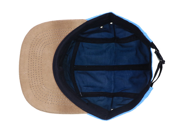 Inside of Baby Blue 5 Panel Hat with Brown Suede Brim and a Leather Label