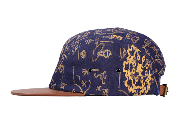 Side of Navy Vintage Style 5 Panel Hat with Brown Leather Brim