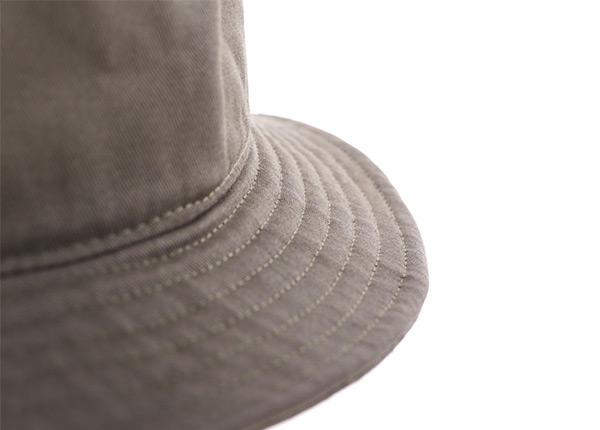 Brim of Khaki Bucket Hat with a Patch Logo