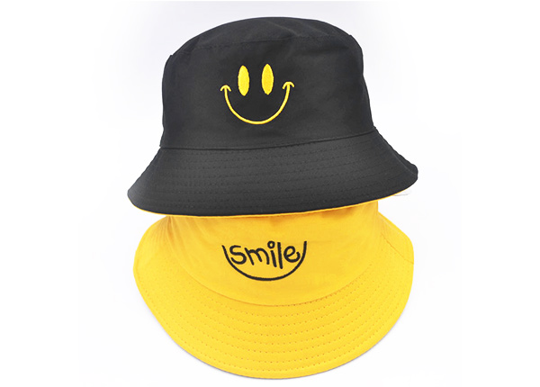 Overview of Reversible Bucket Hat with a Smile Logo