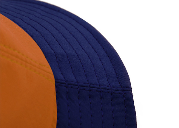 Brim of Orange Cotton Anime Bucket Hat Featuring a Chinese Word Logo and a Navy Brim