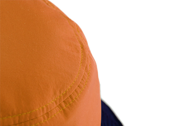 Slant of Orange Cotton Anime Bucket Hat Featuring a Chinese Word Logo and a Navy Brim